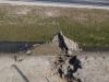 Przykład erozji wodnej przy grodzy filtracyjnej