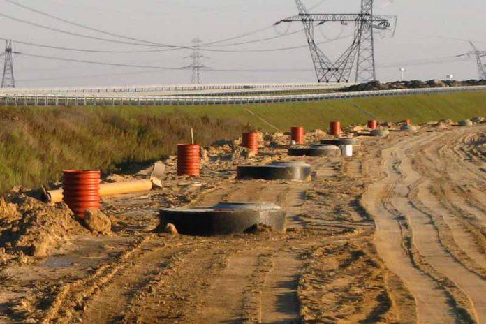 Studzienki kanalizacyjne w jezdni drogi